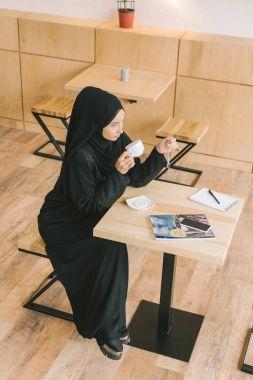 muslim woman drinking coffee