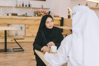 muslim couple having date in cafe