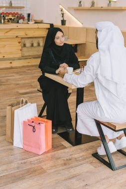 muslim couple sitting in cafe