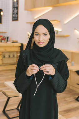 muslim woman with prayer beads