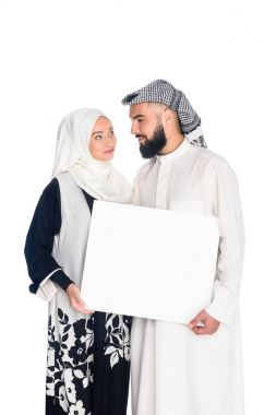 Muslim couple holding blank board isolated on white stock vector