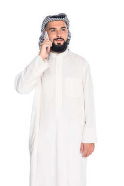 muslim man talking by phone