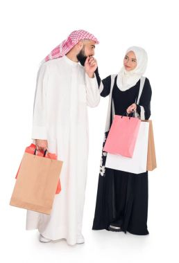Muslim couple with shopping bags