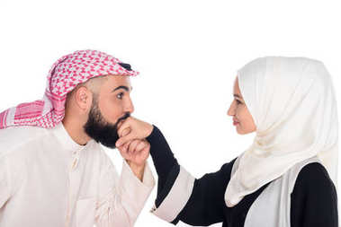 Muslim man kissing hands of girlfriend