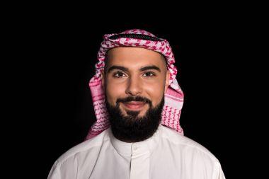 muslim man looking at camera