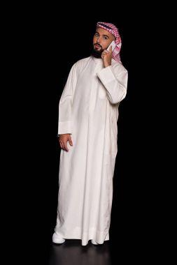 muslim man talking by phone