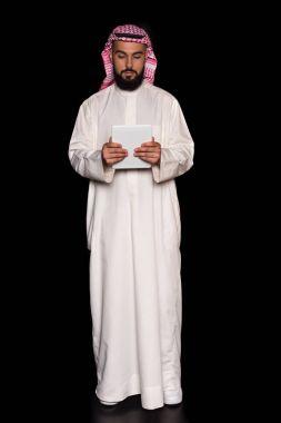 muslim man with digital tablet