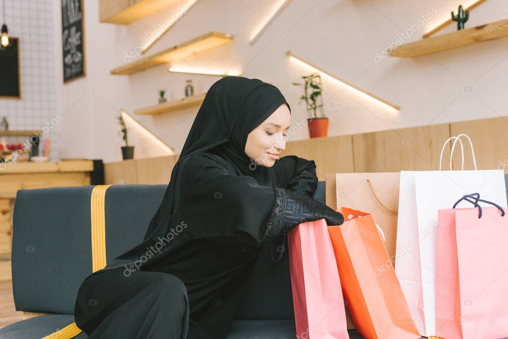 muslim woman with shopping bags