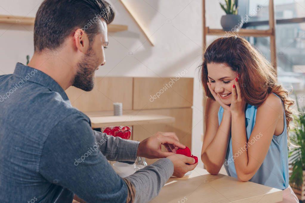 man making proposal to girlfriend