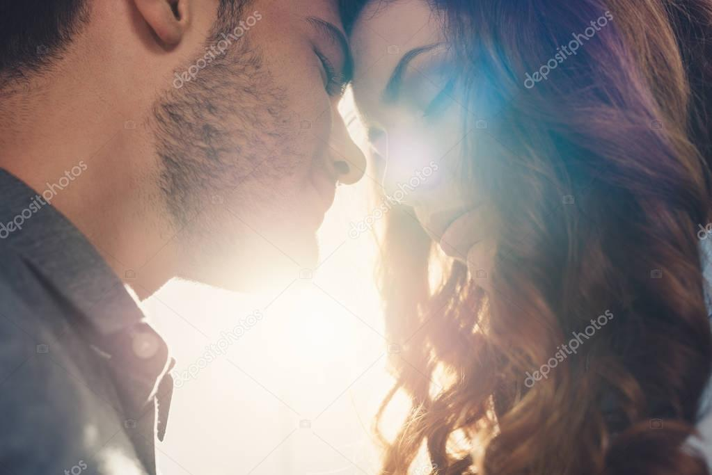 Close up view of sensual couple in love standing head to head stock vector