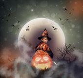 Photo witch on big jack o lantern