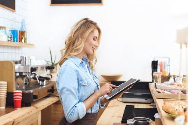 waitress using digital tablet