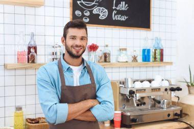smiling cafe owner