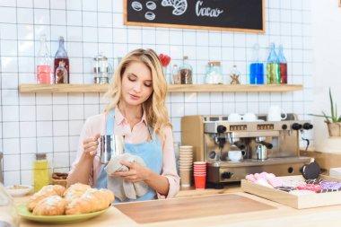 waitress holding jug with milk