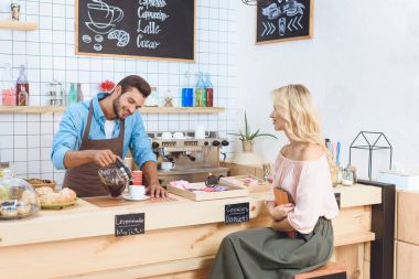 barista and client with digital tablet