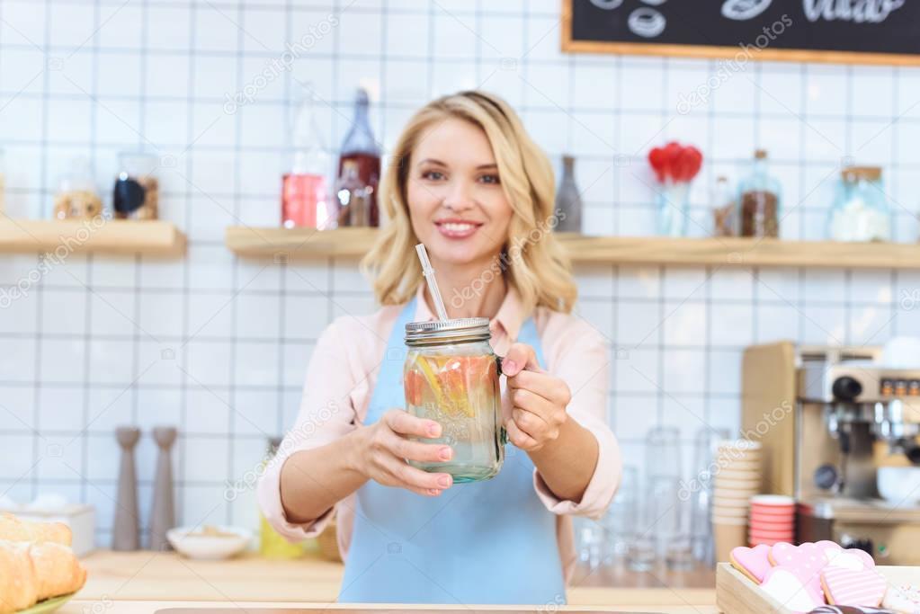 waitress holding jar with lemonade