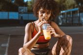 african-american woman drinking juice
