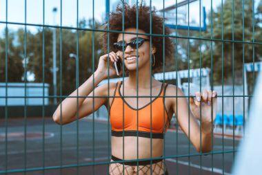 african-american woman talking on smartphone