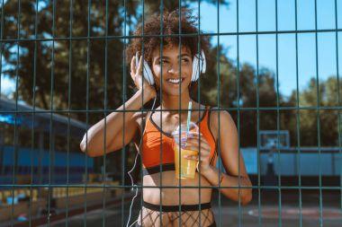 african-american woman listening to music in headphones