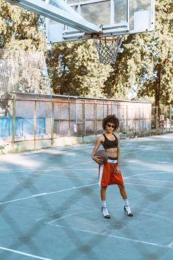 woman in sportswear and heels on sportscourt