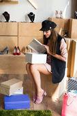 Photo young woman choosing shoes