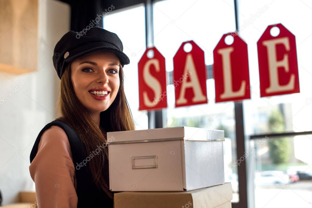 girl with boxes in boutique