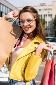 Fotografie girl with shopping bags