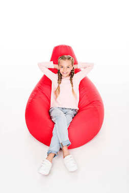 child resting on bean bag