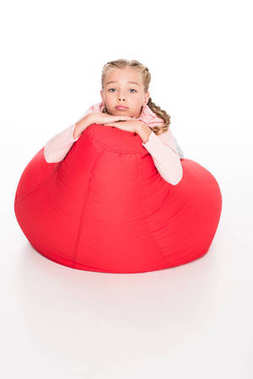dissatisfied child on bean bag