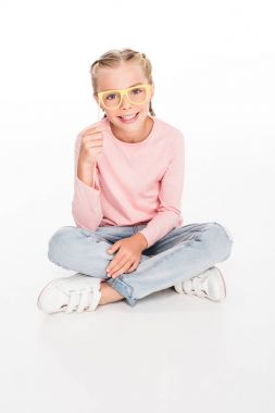 Child with cardboard glasses
