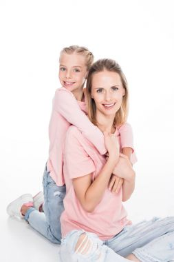 Daughter and mother embracing together