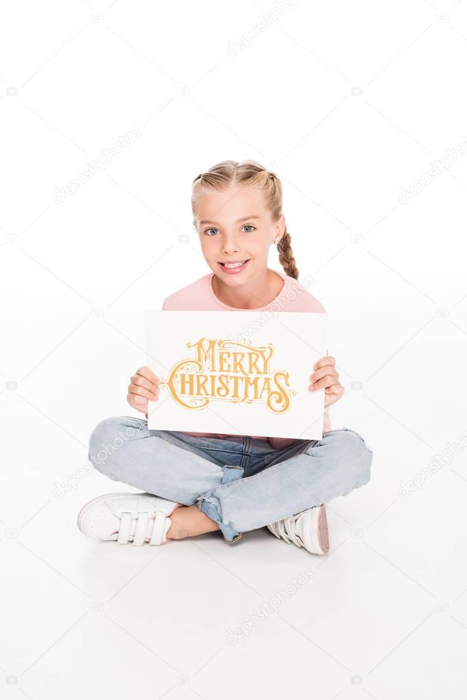 kid with Merry Christmas card