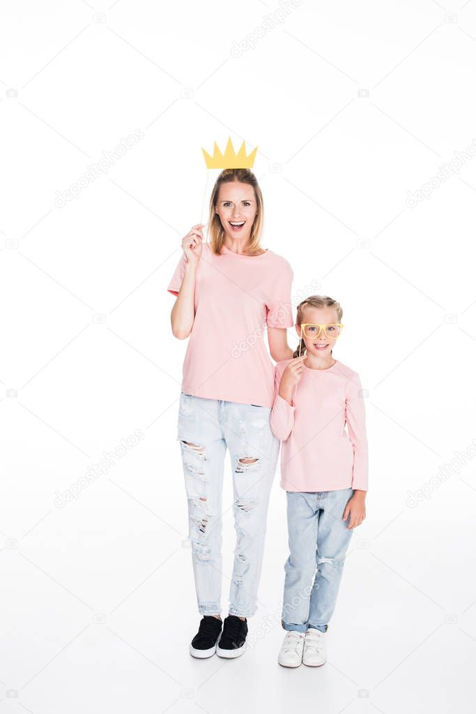 mother and daughter with party masks