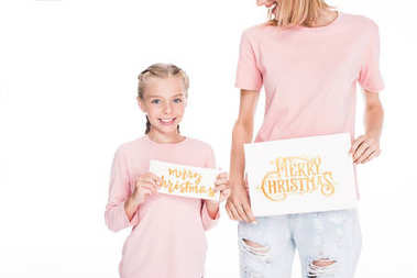 mother and daughter with gifting cards