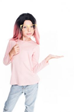 child in pink wig