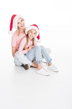 mother and daughter embracing on christmas
