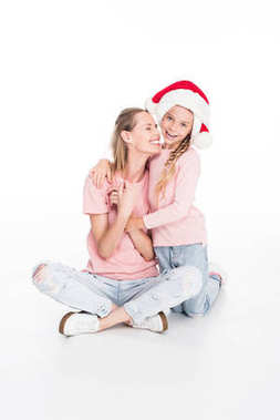 mother and daughter hugging on christmas