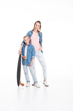 daughter and mother with longboard
