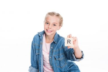 child with aphabet cube