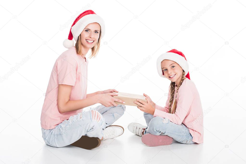 mother and daughter with gift on christmas
