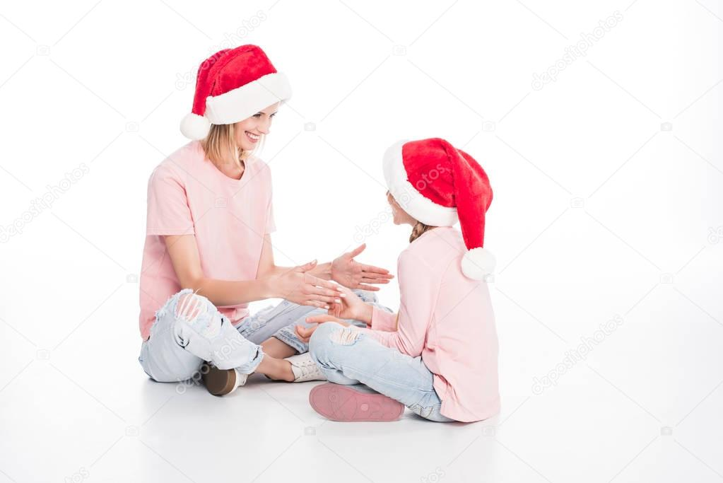 mother and daughter playing on christmas
