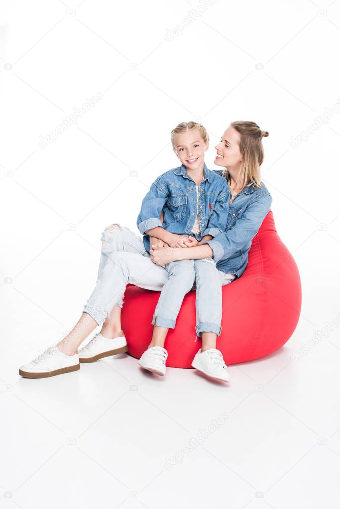 happy mother and daughter on bean bag