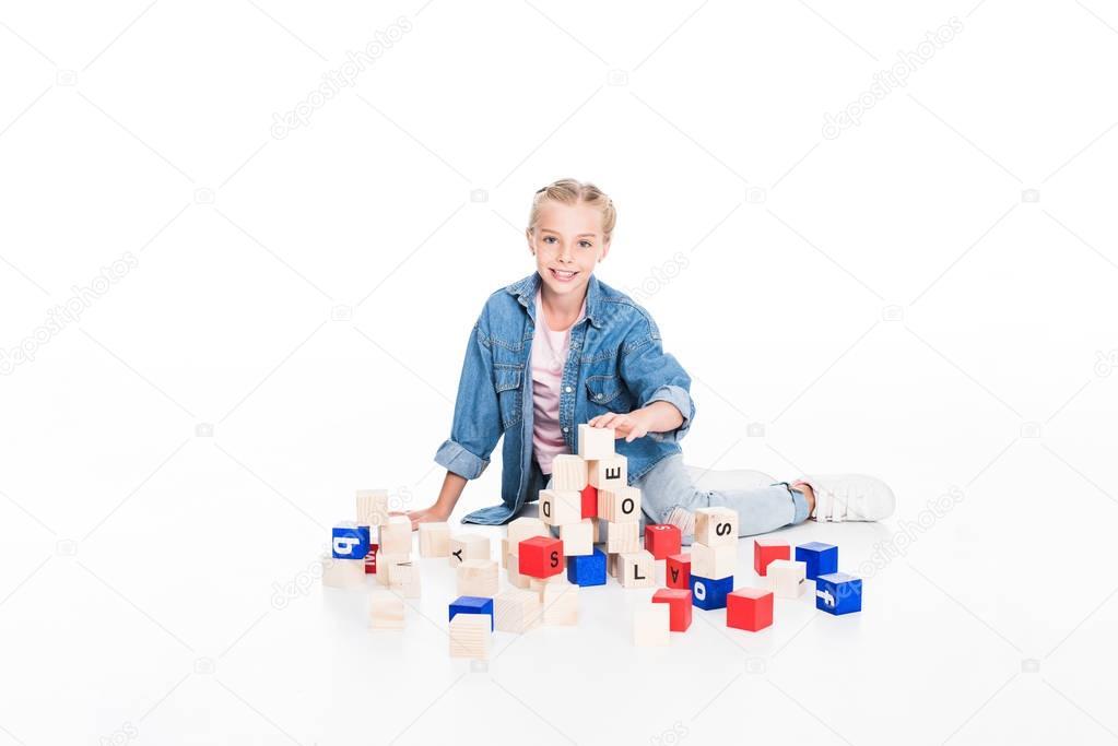 kid with aphabet blocks