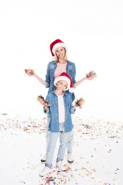 mother and daughter with confetti on christmas