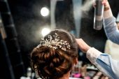 hairstylist fixating clients hairdo