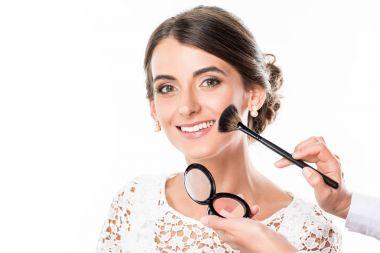 makeup artist applying blush