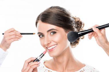 woman getting makeup