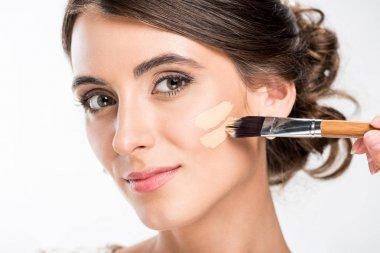 makeup artist applying foundation