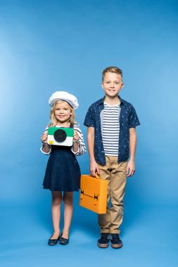 kids with camera and briefcase