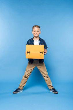 boy with paper briefcase